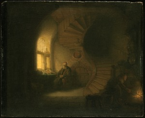 Old man in an interior with winding staircase