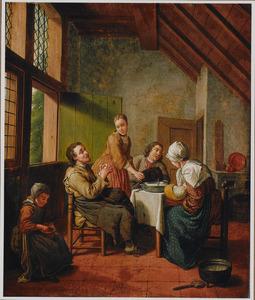 Familie aan de maaltijd in een keuken