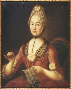 Portret van een vrouw bezig aan een naaiwerkje