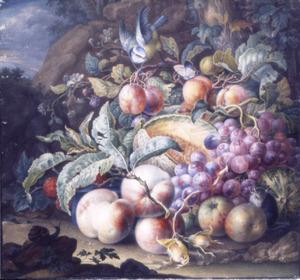 Vruchtenstilleven in een landschap; in de achtergro?d een rots