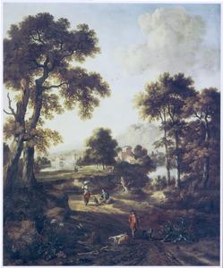 Bebost landschap met jager en twee honden