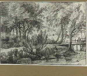 Boslandschap met brug over een beek