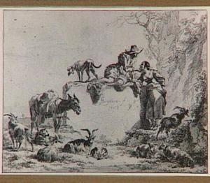 Herders en vee rond een steen