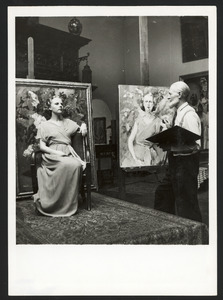 Kees van Dongen met een model in zijn atelier