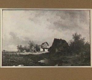 Heidelandschap met hutten