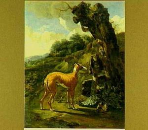 Landschap met windhond bij een kale boom