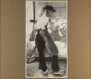 Jonge arbeider aan een spanbok