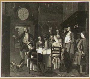 Interieur met gezelschap rondom tafel