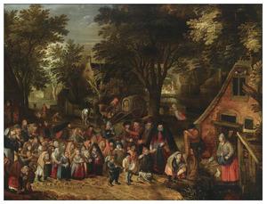 De pinksterblom: een processie van kinderen in een dorpsstraat met Pinksteren
