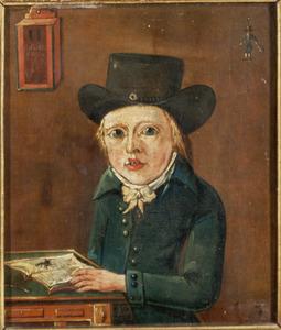 Portret van een jongen staand aan een tafel