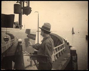 Raoul Hynckes aan het schilderen in een haven