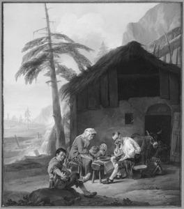 Familie tijdens een maaltijd voor de woning