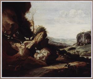 Zuidelijk rotsachtig landschap met geitenhoeders en hun kudde bij antieke ruïnes