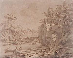 Heuvelachtig rivierlandschap met pad door een rots