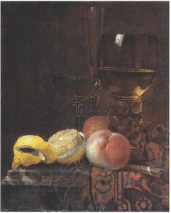 Stilleven met vruchten en glaswerk op een oosters kleed