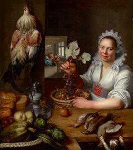 Keukeninterieur met meid met een tros druiven in de hand