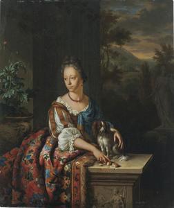 Portret van een jonge vrouw met een spaniel
