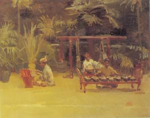 Gamelan spelers onder de palmen