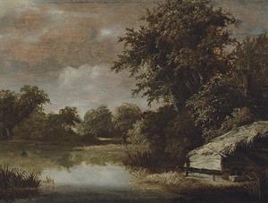 Boslandschap met een hut aan een rivier