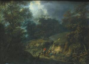 Boslandschap met rustende figuren langs een holle weg