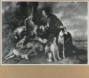 Jager met jachtbuit en honden in een landschap