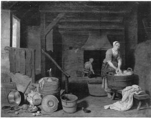 Een vrouw aan de was in een boereninterieur met stilleven van vaatwerk en groente