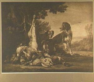 Twee honden in een landschap bij een buit van haas en gevogelte