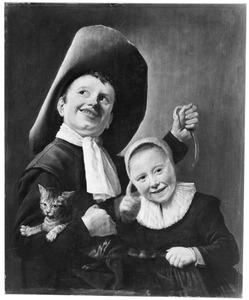 Twee kinderen met een kat en een hazelworm