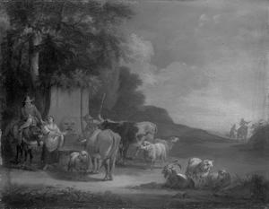 Herders met hun vee bij een bron