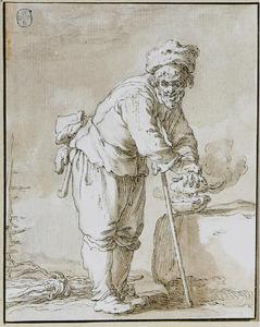 Man handen warmend boven een stoof (De Winter)