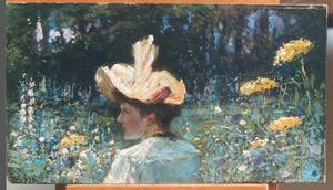 Jongedame temidden van veldbloemen