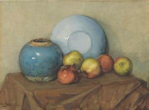 Apples, round pot and plate on a table