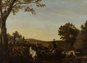 Jagers te paard met honden op vossenjacht