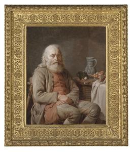 Bebaarde man zittend aan een keukentafel