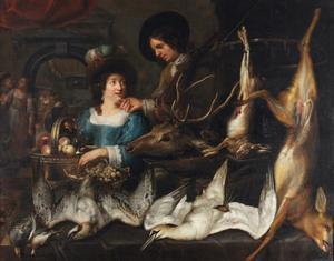 Man en vrouw met geschoten wild op een tafel voor hen en personeel in de keuken achter hen