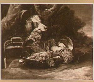 Hond met buit van gevogelte en vogelkooi