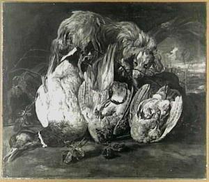 Dood gevogelte en een hond in een landschap