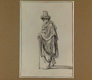 Oude man met stok en hoed