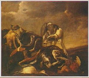 Twee jachthonden bij jachtbuit in een landschap