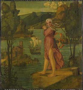 Vrouw staande aan de waterkant