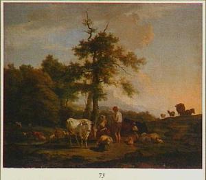 Zuidelijk landschap met herder en zogende vrouw temidden van vee