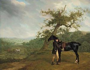 George Irving met zijn zwarte jachtpaard bij een eik