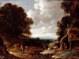 Boslandschap met een heremiet voor een vervallen hut