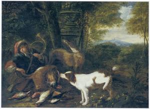 Een jager met zijn honden en jachtbuit in een landschap