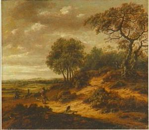 Bebost landschap met jagers op een weg