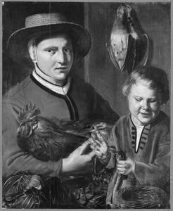 Een vrouw en een jongen met gevogelte