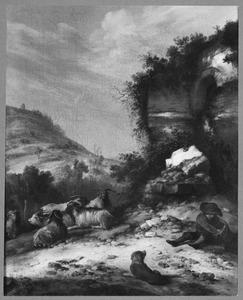 Berglandschap met geitenhoeder en zijn kudde bij een ruïne