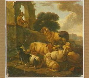 Rustend vee met herder bij een ruïne