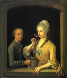 Vrouw en jongeman met een potanjer in een venster