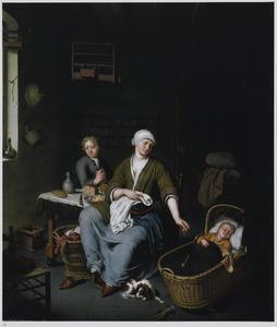 Vrouw met twee kinderen in een kamer